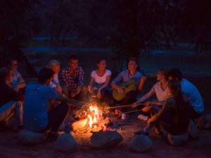 Friends Fnjoying burning firewood